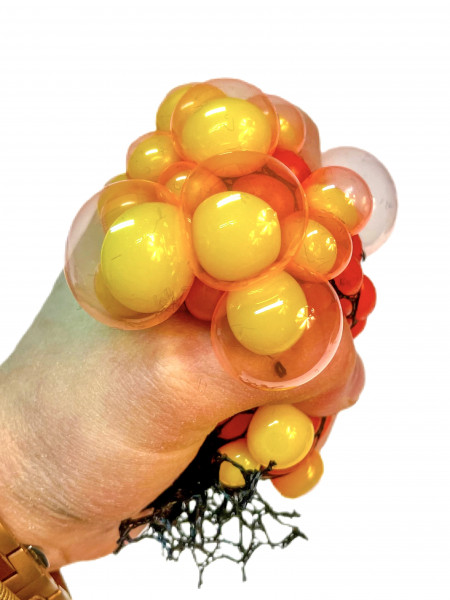 Knautschball im Netz, farbl. sort. DIS, ca. 6cm